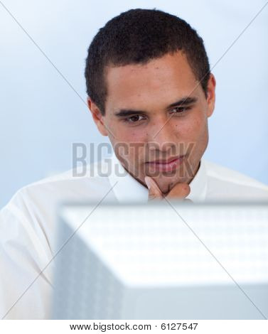 Thoughtful Businessman Working With A Computer