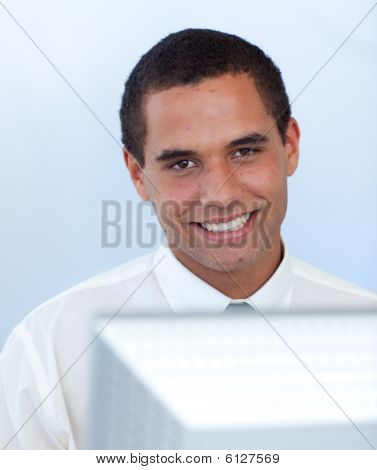 Smiling Businessman Working With A Computer