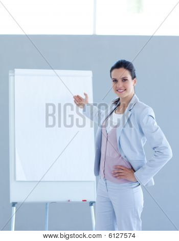 Businesswoman Pointing To A Whiteboard