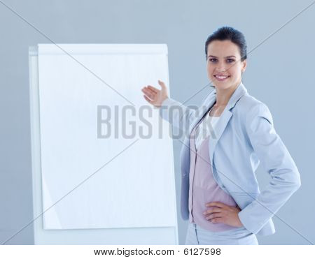 Smiling Businesswoman Giving A Presentation