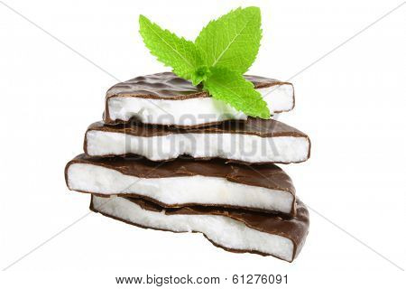 Stack of peppermint candy and fresh mint leaves, cutout, isolated on white background