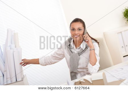 Young Female Architect With Phone