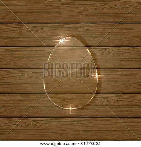 Glossy easter egg on wooden background