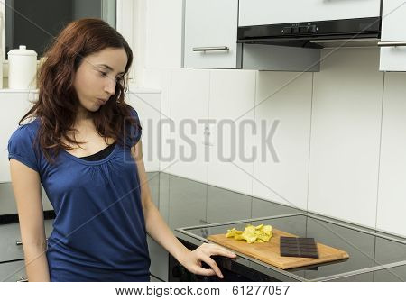 Young Woman Looking At not healthy Food