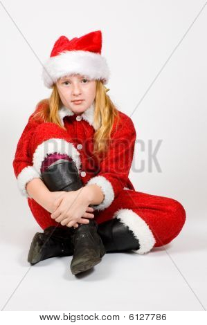 Little Girl Dressed As Santa