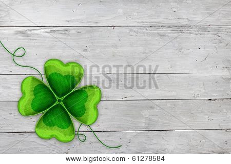Four-leaved clover on white wood