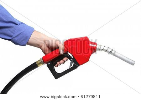 Hand gripping gasoline hose with red nozzle on white