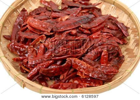 Close Up Of Dried Chillis In Bamboo Plate