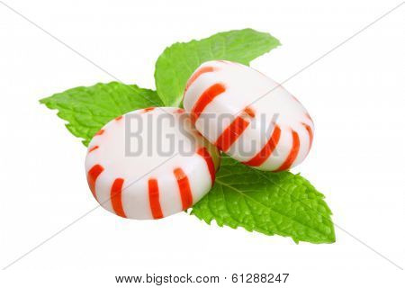 Peppermint candies and mint leaves cutout, isolated on white background
