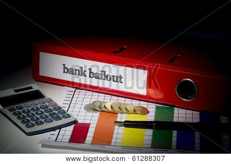 The word bank bailout on red business binder on a desk