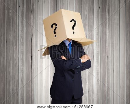 Businessman wearing on head carton box with marks