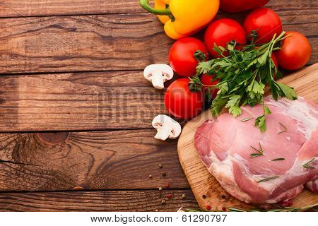 Food. Raw meat for barbecue with fresh vegetables