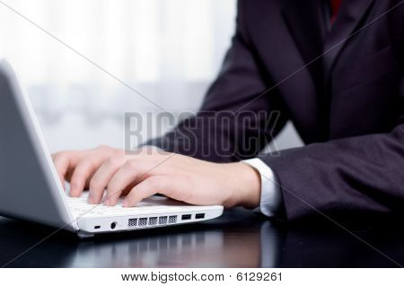 Businessman typing on a notebook