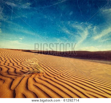 Vintage retro hipster style travel image of dunes of Thar Desert. Sam Sand dunes, Rajasthan, India with grunge texture overlaid