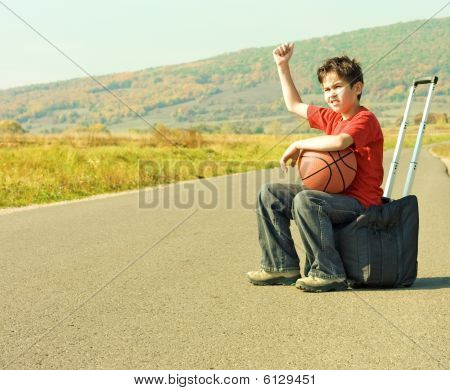 Little Boy Hitching On Road