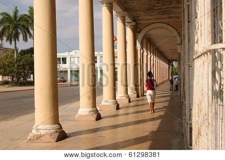 People Under Arches In Cuba