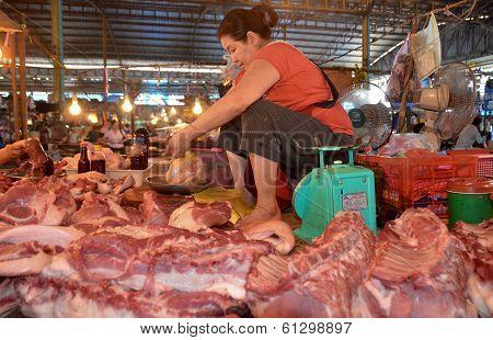 Woman sells raw meat