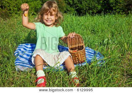 Pretty Little Girl Keeps In Hand  Sweet Cherries In Garden