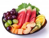 stock photo of dessert plate  - a plate with different kinds of fresh fruit - JPG