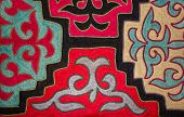 image of yurt  - Kazak felt carpet with ornament on the wall of the yurt - JPG