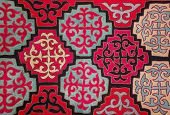 stock photo of nomads  - Kazak felt carpet with ornament on the wall of the yurt - JPG