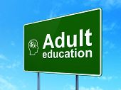 Education concept: Adult Education and Head With Finance Symbol on road sign background