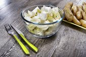 image of endive  - small bowl of endives with potatoes and cutlery - JPG
