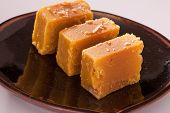 stock photo of ghee  - Mysore Pak is a Sweet dish made from gram flour - JPG