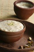 picture of mishti  - Mishti Doi or Mishti Dahi or Mitha Dahi translate as sweet dahi or sweet yogurt. This type of yoghurt is common in the states of Orissa and West Bengal in India. It is made with milk, and sugar while also using yogurt and curd.