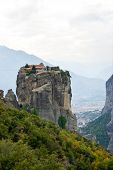 stock photo of trinity  - The unusual greek landscape with monastery of Holy Trinity on the top of the Meteora rock Greece - JPG
