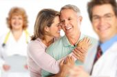 stock photo of elderly couple  - Smiling medical doctor with stethoscope and elderly couple - JPG