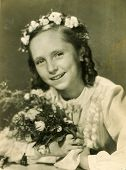 LODZ, POLAND, SEVENTIES - Vintage photo of little girl at her First Communion