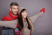 winter couple with outstretched arms