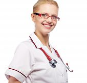 Close-up portrait of a female doctor smiling with arms crossed. Isolated on white background.