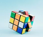 stock photo of brain teaser  - toy cube on with blue background - JPG