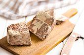 image of sugar paste  - pieces of tasty halva on kitchen table - JPG