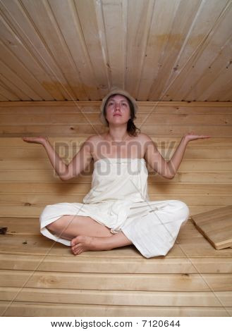 Young Woman Doing Yoga  At Sauna Bath