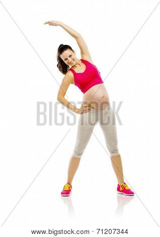 Pregnant fitness woman isolated on white
