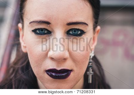 Closeup Of A Pretty Goth Girl Posing In Urban Landscape