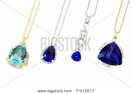 Four Different Designer Pendants with Tanzanite, Aquamarine and Diamonds, Isolated on White Backgrou