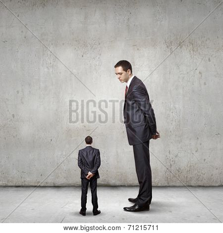 Two businessman of different size. Leadership concept