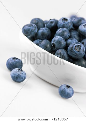 Blueberries in a bowl on a white