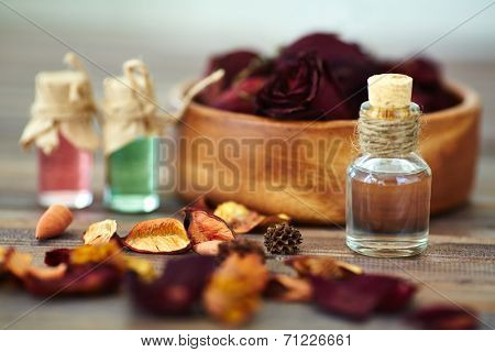 Dry rose petals and aromatic essences in small bottles