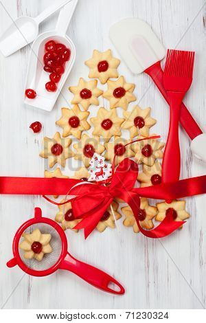 Homemade Christmas cookies and different kitchen utensils