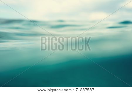 Water. Sea. Ocean, Wave close up. Nature background. Soft focus. Image toned and noise added.