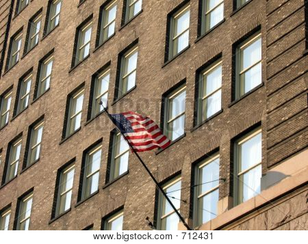 Flag On Old Brick Building