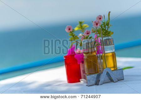 Bottles Of Olive Oil And Vinegar On The Table In Greece
