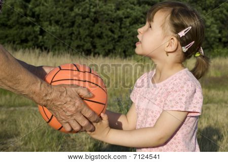 hands of garandmother and ball