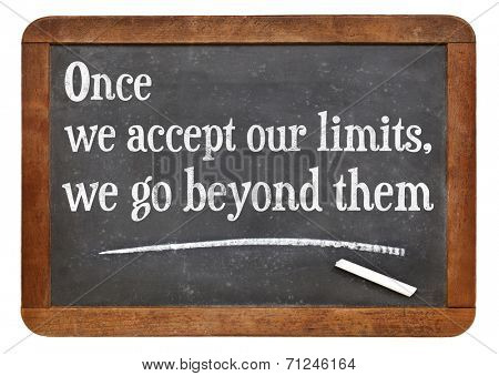 once we accept our limits, we go beyond them - a quote from Albert Einstein on a vintage slate blackboard