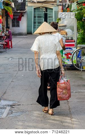 old woman going to the market